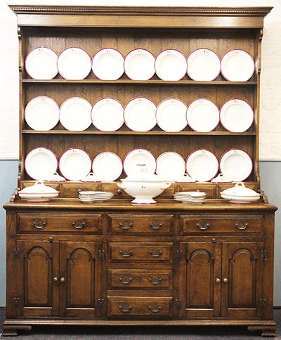 A George III style oak dresser £300
