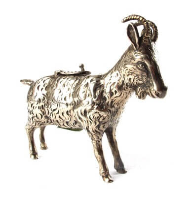 A novelty 'cow creamer' in the form of a goat