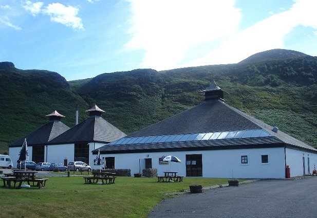 The exterior of Arran distillery with picnic tables