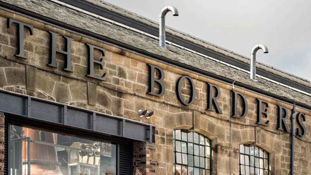 Sign saying The Borders the distillery in Scotland